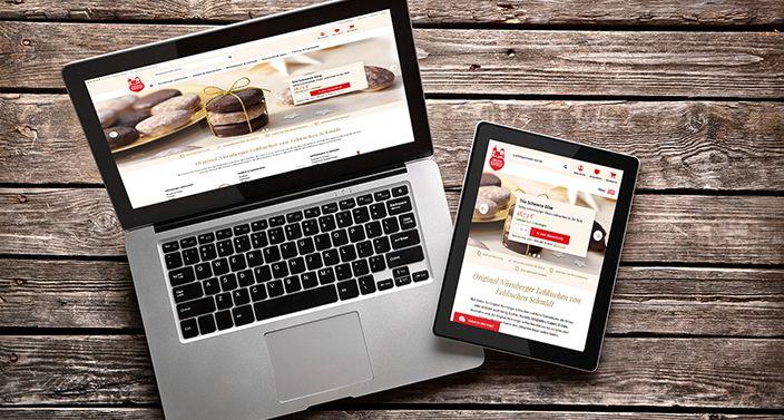 Laptop und Tablet zeigen die Webseite von Lebkuchen-Schmidt
